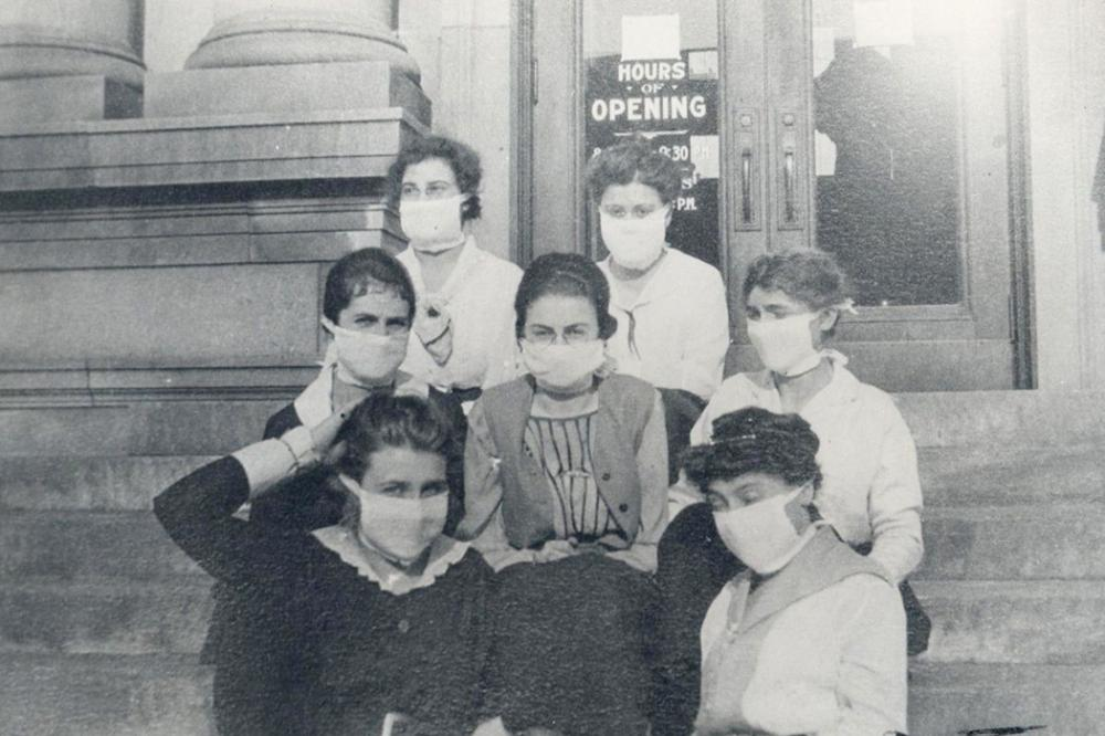 Librarians in Gary, Indiana protect themselves with masks in October 1918 during the flu pandemic. via Calumet Regional Archives